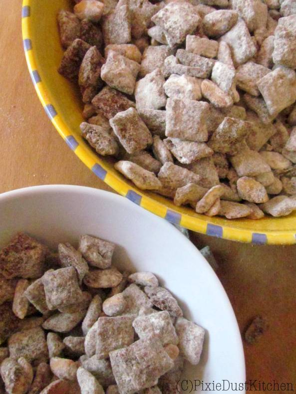 Snickers Puppy Chow Muddy Buddies. Chocolate and caramel coated chex cereal with caramel and peanuts. From pixiedustktichen.com